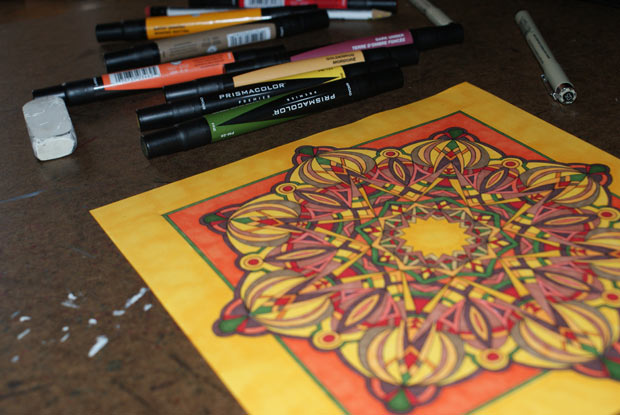 kaleidoscope like shape in autumn colors with markers
