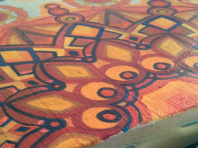 detail show of navy red orange red and yellow kaleidoscope like painting