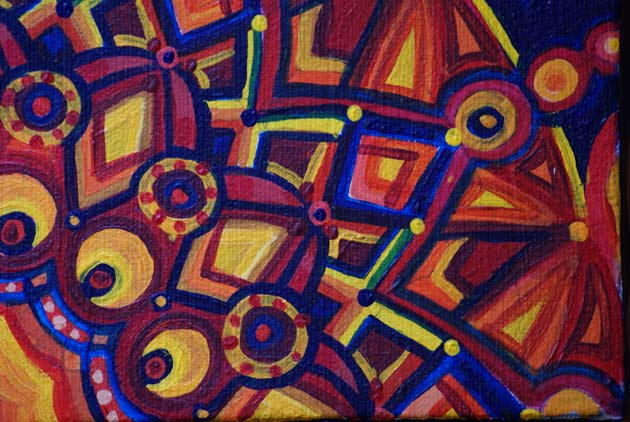 close up view of acrylic kaleidoscope painting in red yellow orange and blue